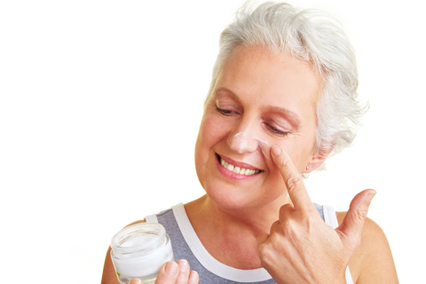 older-woman-with-jar-of-face-cream