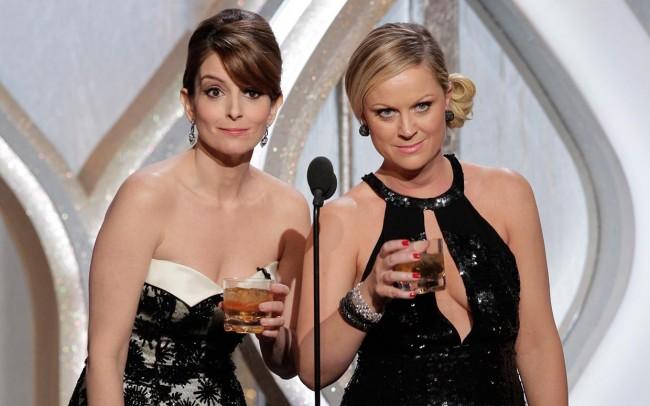 Актерките Тина Феј и Ејми Пулер - овогодинешните водителки на настанот