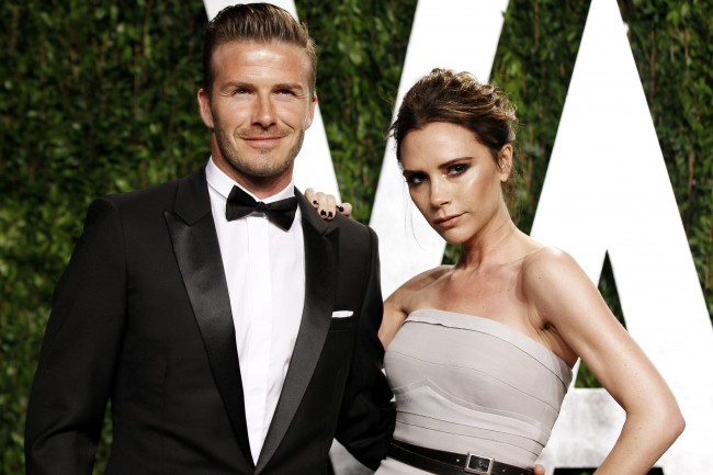 Soccer player David Beckham and his wife, singer Victoria Beckham, arrive at the 2012 Vanity Fair Oscar party in West Hollywood